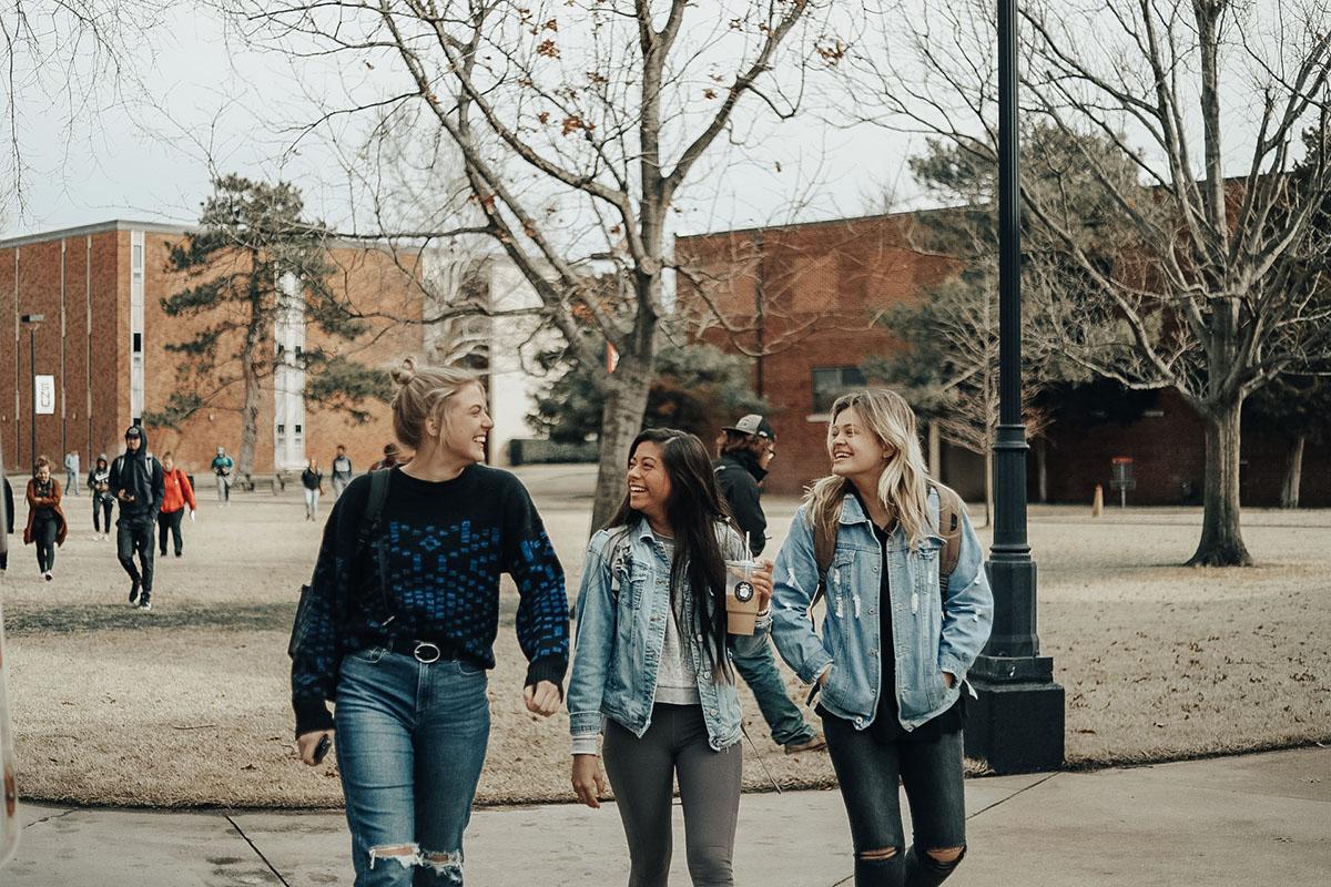 Three girls talking outside