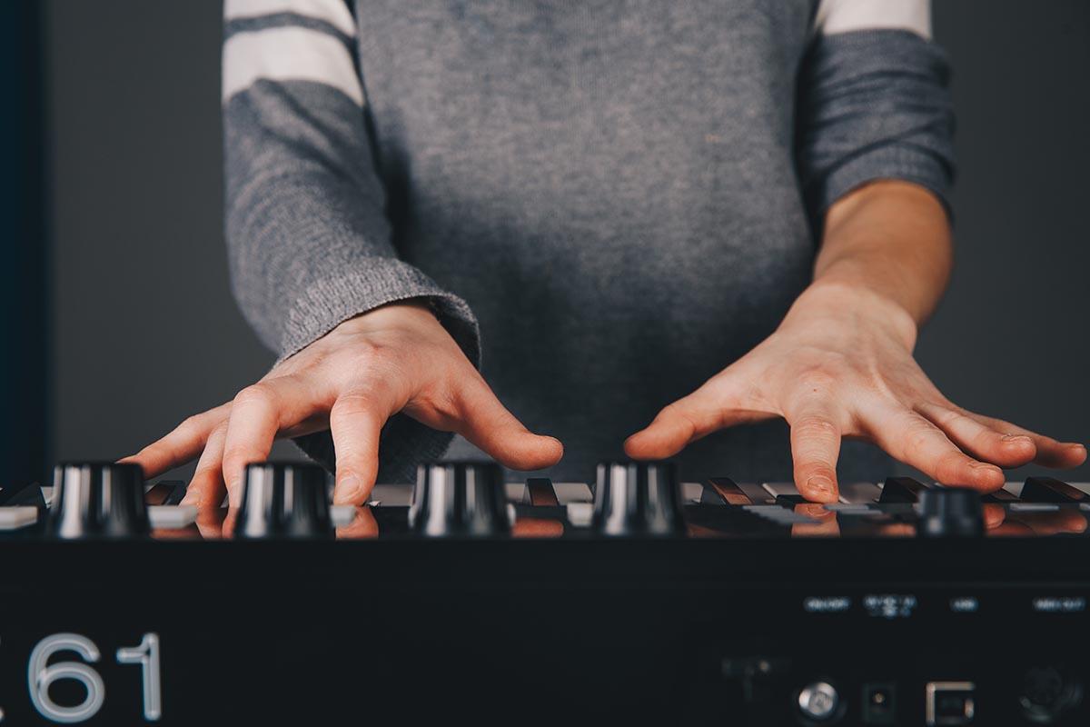 girl playing a keyboard