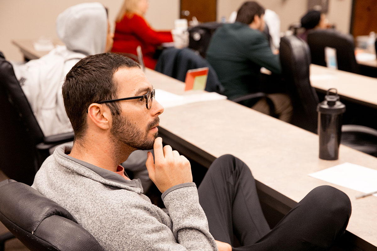 Student listens to lecture in class