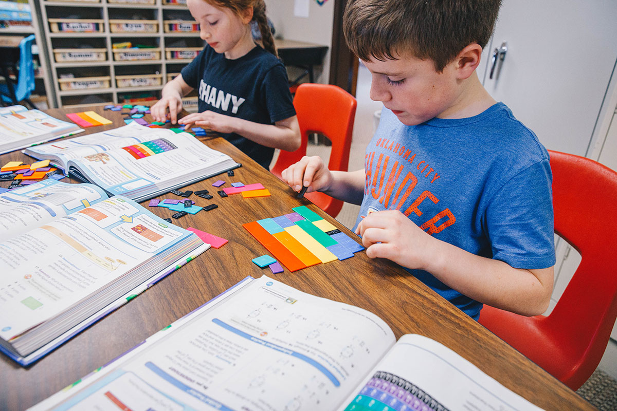 Elementary students work in class