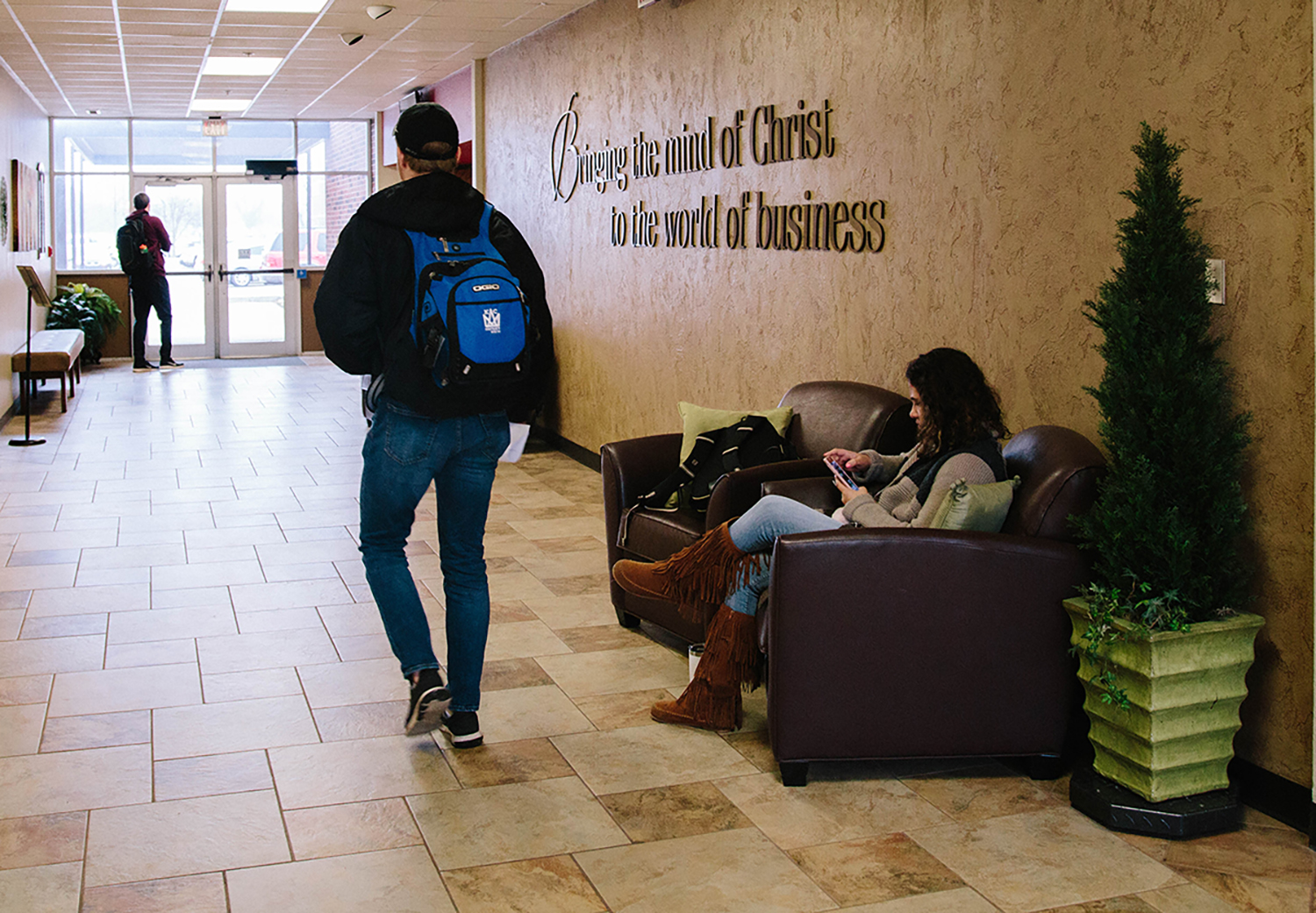 students walking in the school of business building