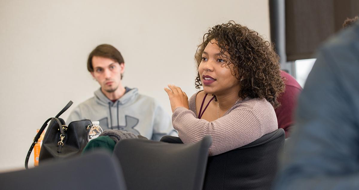 girl sitting in class listening