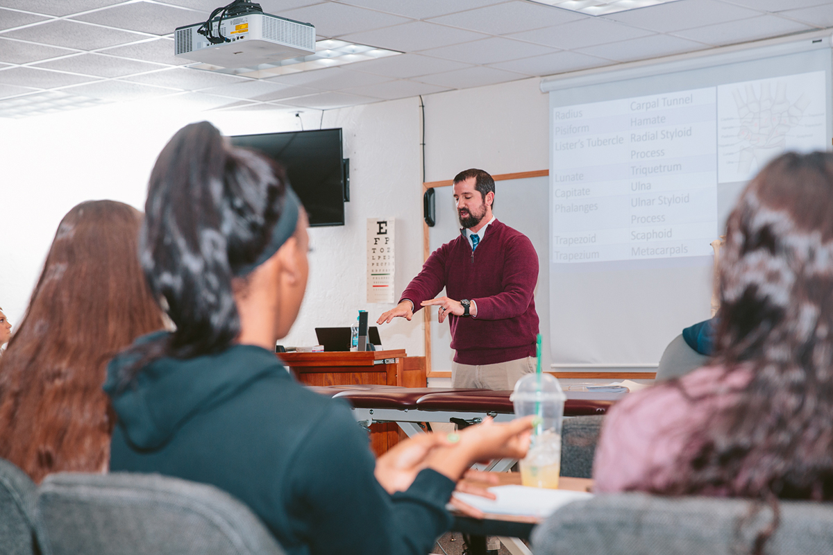 sports management professor teaching in class